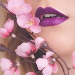woman-showing-her-purple-lipstick